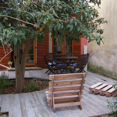 terrace with table and deck chairs