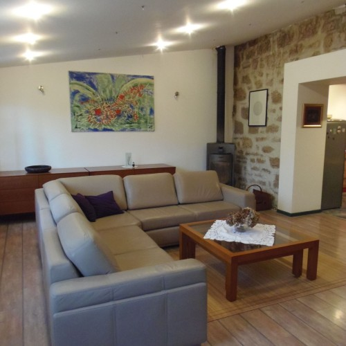 living room with fire place and Tomislav Ostrman's painting